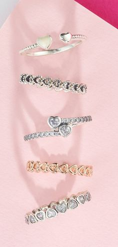Stack you two-tone PANDORA heart rings for a loving statement.