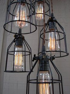 Nicole/Industrial Style 5 Light Pendant with Bulb Cages and Brushed Aluminum Canopy (̏◕◊◕)̋ neat old industrial lights. i have to get me some of these Edison bulbs!(̏◕◊◕)̋ neat old industrial lights. i have to get me some of these Edison bulbs! Industrial Style Lighting, Industrial House, Industrial Interiors, Modern Industrial, Home Lighting, Lighting Design, Industrial Design, Pendant Lighting, Light Pendant