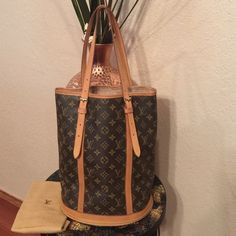 Authentic LV Bucket GM In great shape, leather had nice patina. Other than one water mark exterior is in great condition. Hardware is still nice & shinny. Interior has peeling not sticky however can get re-lined at any Lv location for less than $200, you'll practically have a new handbag. Price is negotiable  Date code: SP 0978 Louis Vuitton Bags Shoulder Bags