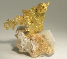 Gold on quartz.