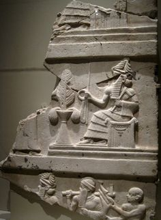 A fragment of the Stele of Ur-Nammu from the ancient city of Ur in Southern Mesopotamia depicting the Sumerian god Nanna (the Moon God) bestowing the symbols of kingship: the rod and ring. The Metropolitan Museum of Art, New York City, NY.