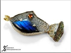 My contemporary fish    Pendant: Sterling silver, 18kt yellow gold, labradorite, fire opal, rock crystal with tourmaline