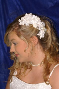 Ivory Fabric Kanzashi Flowers Side Comb: Bridal / Wedding Hair. $85.00, via Etsy.