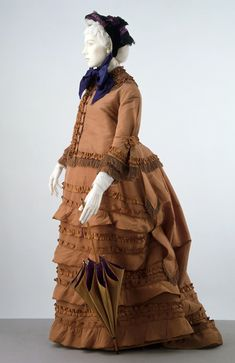 Maternity dress and jacket ensemble, English, circa 1870. Brown silk, satin ribbon, silk fringe.