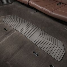 Suburban Floor Mats, Premium All Weather, Third Row, Cocoa: Keep the third row seat floors clean with these Premium All-Weather Rear Floor Mats. Their deep-ribbed pattern collects rain, mud, snow and debris.