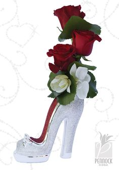 We love this glamorous high-heel bud vase! A trio of red roses and white orchids are the perfect accent for this sparkly shoe. #PennockFloral