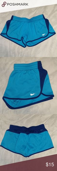 Nike running shorts Blue shorts with navy detailing. In great used condition. Has a small pocket to hold a key as shown‍♀️ Nike Shorts