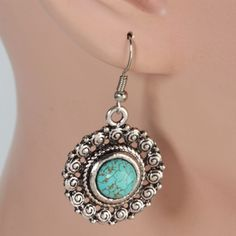 Swirly Turquoise Earrings: http://www.outbid.com/auctions/13998-southern-jewelry-auction#14