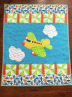 Airplane in Happy Clouds Baby Quilt Pattern Quilt Baby, Baby Quilts Easy, Airplane Fabric, Airplane Quilt, Strip Quilts, Panel Quilts, Baby Quilt Panels, Boys Quilt Patterns, Quilting Patterns
