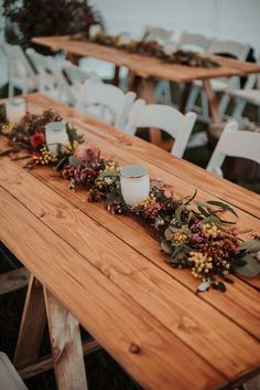 Rustic chairs and wooden table with | Image by Shannon Stent Images #fall #fallwedding #rustic #rusticwedding #countrywedding #wedding #weddinginspo #weddinginspiration #reception #weddingreception #centerpieces #tablerunner #outdoorwedding #outdoorreception