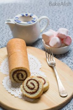 This fluffy cake roll is wrapped with creamy Nutella and taste absolutely divine. Nutella Swiss Roll is an easy, delicious cake recipe you must try. Roll Cake Recipe Vanilla, Cake Roll Recipes, Delicious Cake Recipes, Yummy Cakes, Swiss Steak Recipes, Swiss Chard Recipes, Nutella Rolls, Roulade Recipe, Swiss Roll Cakes