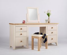 New England Painted Double Pedestal Desk This is a beautiful desk/dressing table  Clean fresh lines and lightly painted in ivory  It has six deep drawers The drawers are tongue and groove With contrasting wooden knob handles The top is solid ash that has been lightly lacquered This is a satin finish which is resilient and serves to protect the natural beauty of the ash The frames are solid pine With high quality MDF panelling Finished in a knock resistant paint in ivory