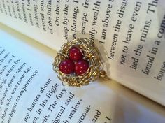 Birdsnest ring  Red beads wrapped in gold wire   $25