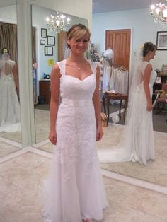 http://www.davidsbridal.com/Product_Lace-Cap-sleeve-Trumpet-with-Keyhole-Back-and-Sash-VW9768_Bridal-Gowns-Features-All-Gowns Like the shape and style