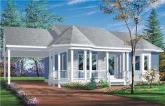 This house plan has a porch that wraps from the front to the carport on the side.  The bay window that can be seen from the front is part of a magnificent master bedroom.  The kitchen features an island with an eating bar on the outside.
