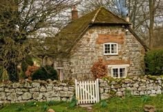 The Murmuring Cottage (like roof and stone fence)