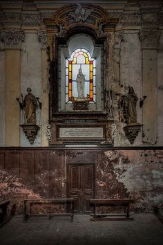 Amazing stained glass window in an abandoned church