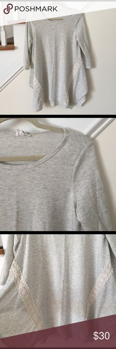 """Gray trapeze top💙 Like new! Worn once. Gray space dye tunic. 3/4 sleeves. Crochet/lace detail. Incredibly soft. Light-medium weight. Soft on the inside too. Boutique quality. Adorable with leggings or skinny jeans😊51% cotton and 49% polyester. Bust 18"""" and length 30""""💕 fantastic fawn Tops Tunics"""