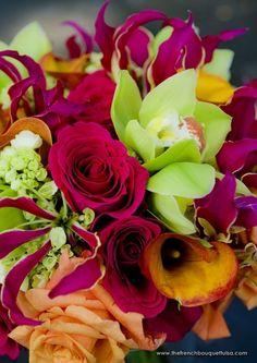 Hot Pink Princess Roses, Bright Green Cymbidium Orchids, Mango Milva Roses, Mango Calla Lilies, Lime Green Hydrangea, and Gloriasa Lilies