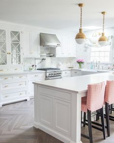 Two twinning Hicks' pendants in one of my favorite past design projects. It's always a good sign when the most interesting elements in a room come from the architectural character of a home: herringbone floors, inset drawers & glass-paneled cabinetry...what a kitchen!#caitlinwilsondesign {Shop Hicks Pendant by tapping the photo}