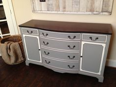 Gorgeous antique buffet redo. I used Annie Sloan's French linen and old white. I also stained the top in a dark walnut stain.