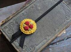 Hand Embroidered Headband Wool Felt in Mustard Yellow Scarlet Red and Turquoise by love maude. $16.00, via Etsy.