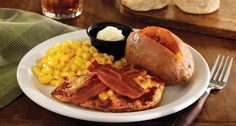 A grilled chicken breast glazed with cider BBQ sauce, topped with melted Colby and White Cheddar cheeses and our thick-sliced hickory-smoked bacon. Served with your choice of two Country Vegetables and made-from-scratch buttermilk biscuits or corn muffins.