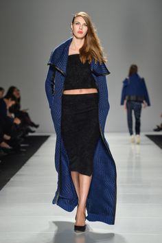 Long flowy coat. When I wear a coat this is one I would definitely wear (red would be better though)