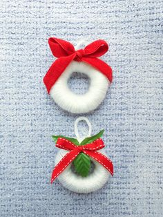 Real quick DIY, cut toe part of your socks and roll it up into a wreath shape and wrap it tight with yarn and decorate creatively.