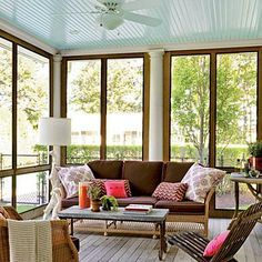 Trendsetter Amanda Nisbet uses playful patterns and a mix of wicker and wood to add interest to this sun porch. | Coastalliving.com