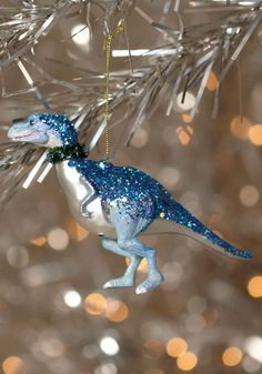 Because Target has already been in full-blown Christmas mode for two weeks now, here's some dinosaur tree ornaments. I know there are already a ton of other dinosaur ornaments out there, but these ones are all fun and sparkly. Christmas Projects, Kids Christmas, Holiday Crafts, Christmas Dinosaur, Christmas Shopping, Holiday Ideas, Plastic Animal Crafts, Plastic Animals, Unique Christmas Trees