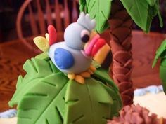 Gum paste Toucan sitting in palm tree made with gum paste leaves