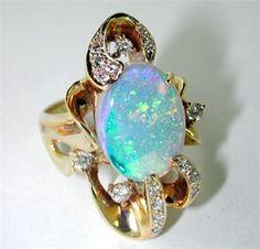 White Opal Ring set with Diamonds in 14 Karat Gold