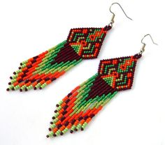 Native American style  seed bead earrings - boho style, dangle long earrings, peyote earrings, long beaded earrings, orange / green. via Etsy.