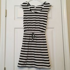 Black and White Striped Dress Black and White Striped Dress. Drawstring waist. Gently used condition. Normal signs of wear. Great everyday dress! Old Navy Dresses