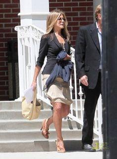 Jennifer Aniston wearing Ray-Ban 3025 Aviator Metal Sunglasses, Prada Crisscross Sandal, Reyes Surfer Skirt, Rick Owens Wool-Felt Blazer and Bottega Veneta Beige Large Veneta Hobo Bag with Fringe.