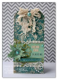 Blue Winter Wonderland Tag...with pearlized swirls, flower, bow, & lace.