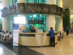 pre paid taxi meter counter in arrivals hall. after you have taken the walk through the small duty free section in the airport you will be greeted by many taxi drivers wanting to take you to your destination in Bali. this counter is directly opposite you when you exit the duty free section.