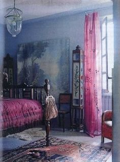 This dusky blue and pink bedroom has a wonderful romantic feel to it. I love the oriental carpet and large painting.