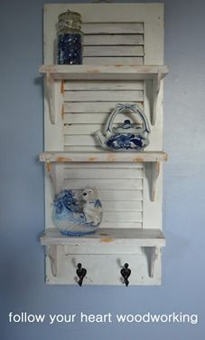 Repurposed Shutter Shelf with hooks.  I love, love, love shutter projects, and this one is perfectly sweet with those shelves.