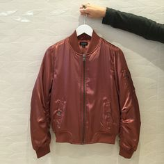 The classic bomber jacket gets a new school revamp in a high shine copper finish. We'll be wearing ours with muted tones and straight leg jeans for offbeat chic. #Topshop