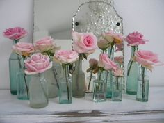 Green bottles and pink roses