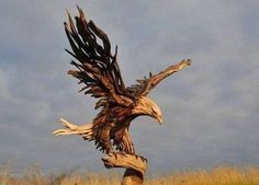 A cool sculpture of an Eagle carved out of driftwood by artist Jeff Uitto