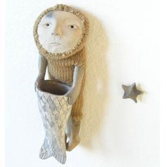 I love the knitted hoody and fishtail costume of this figure by Kate Fitzharris.