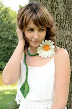 This daisy necklace is a folk jewelry to wrap around your neck. It is perfect for women who have romantic soul.