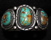 Classic 3 stone turquoise bracelet with red matrix