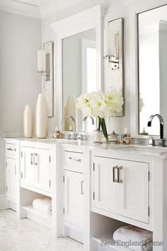 Custom vanities have simple nickel fixtures.