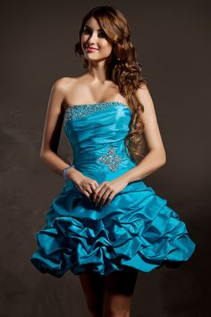 Blue party dress with pick-up skirt