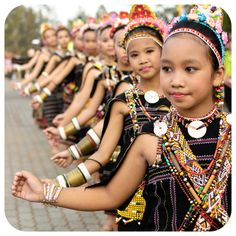 """""""Mongigol Sumandai"""" Performed by a group of local from Misompuru Homestay With Beautiful Traditional Costume of Rungus During The Sunset Orchestra at The Tip Of Borneo 2012.."""