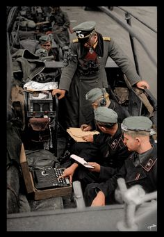 WW2 - Axis Special Weapons & Equipment: German command vehicle with signallers and 3-rotor Enigma cipher machine in foreground.